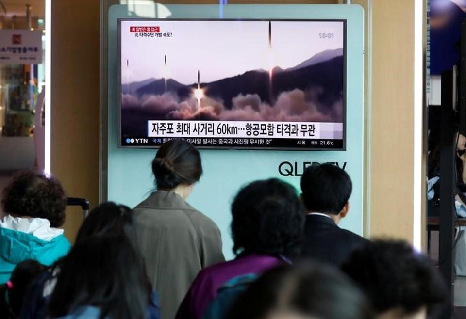 People watch a TV broadcasting of a news report on North Korea's missile launch, at a railway station in Seoul, South Korea, on Saturday.