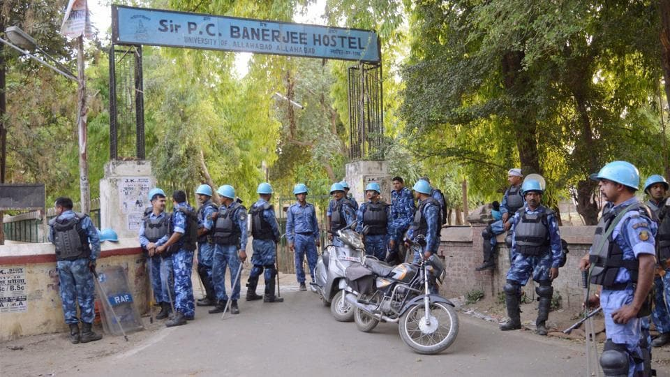Rapid Action Force personnel stand guard outside a hostel of Allahabad University on Saturday.