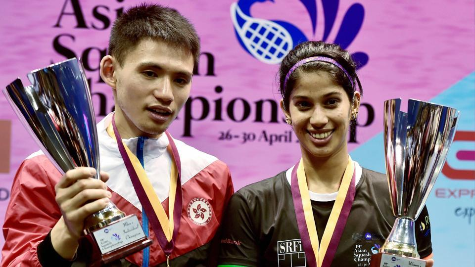 India's Joshna Chinappa and Hong Kong's Max Lee (L) pose with their trophies after the 19th Asian Squash Championships in Chennai on Sunday.