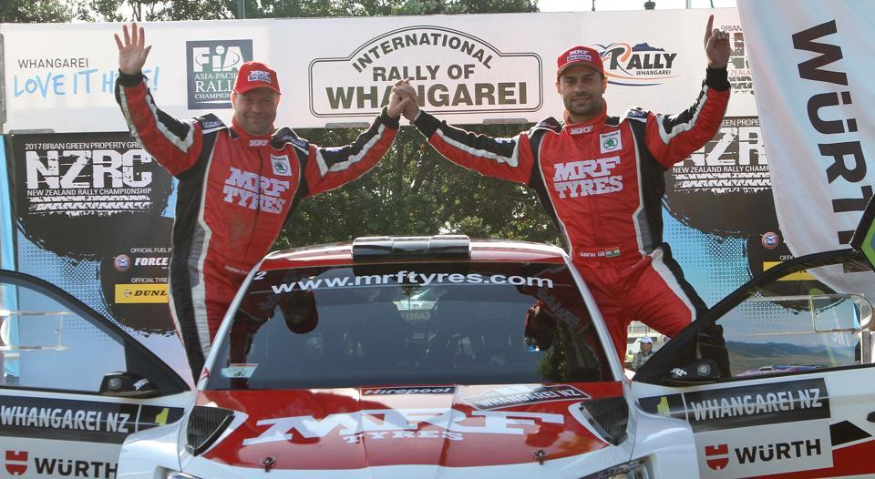 Gaurav Gill and co-driver Stephane Prevot  (Belgium) of Team MRF Tyres celebrate at the podium of the International Rally of Whangarei in New Zealand on Sunday.
