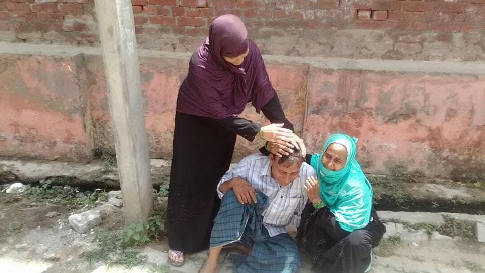 Relatives consoling Babu Khan, the father of eight-year-old Rehan who was killed in celebratory firing in Kasganj district.