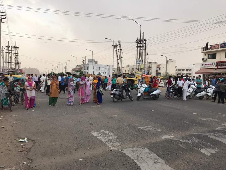 The residents of Sector 57 holding a road blockade on Sunday.