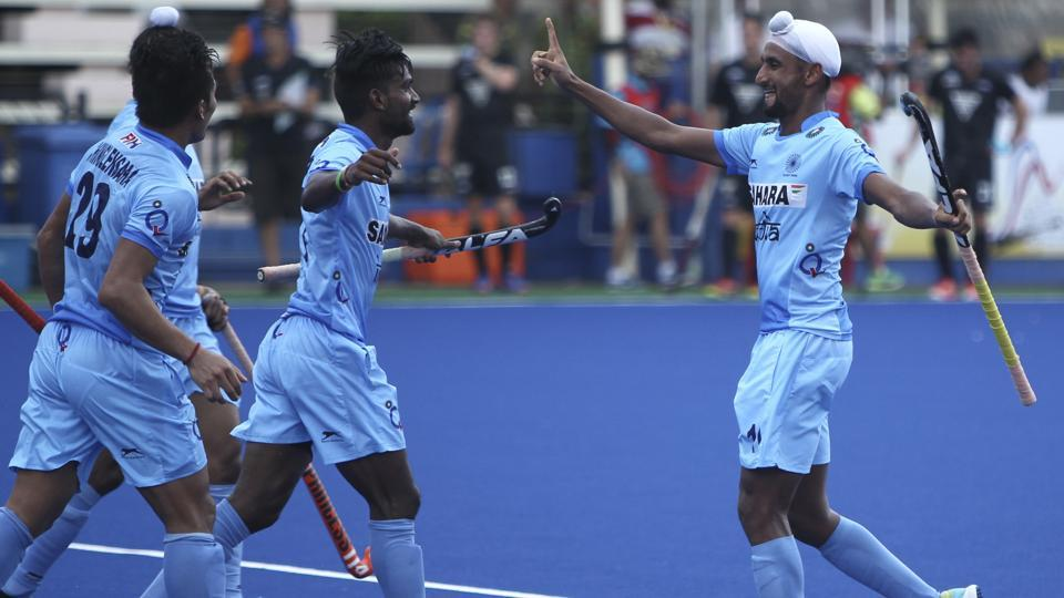 Mandeep Singh (right) celebrates with teammates after scoring Indian hockey team's opening goal against New Zealand at the Sultan Azlan Shah Cup in Ipoh, Malaysia, on Sunday.