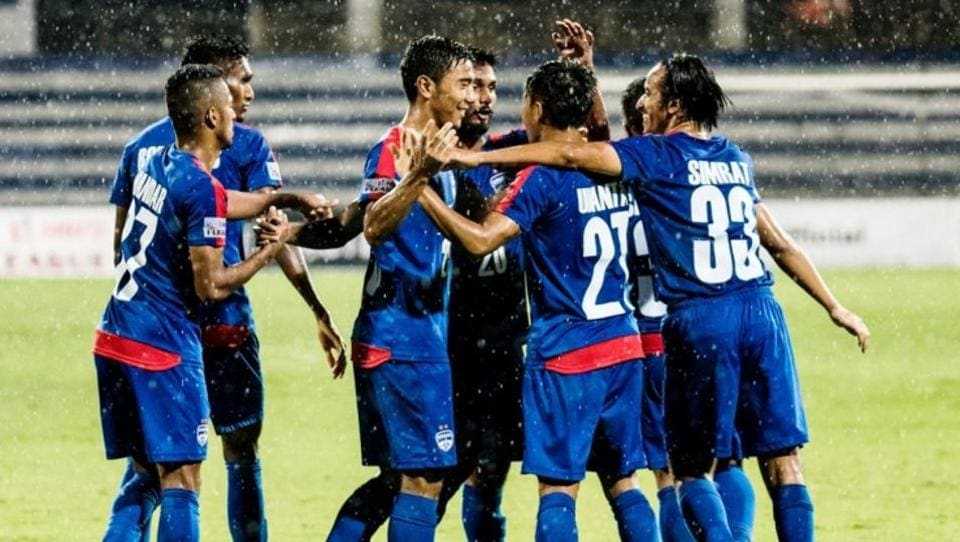 Bengaluru FC players celebrate a goal against Churchill Brothers in the I-League on Saturday.