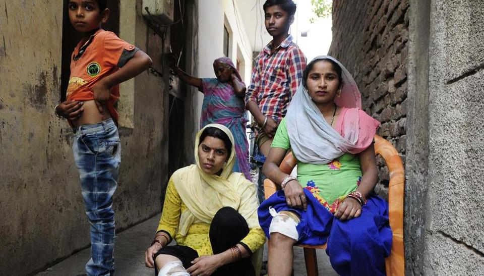 Victims showing their injuries marks at Mauli Jagran in Chandigarh on Saturday.