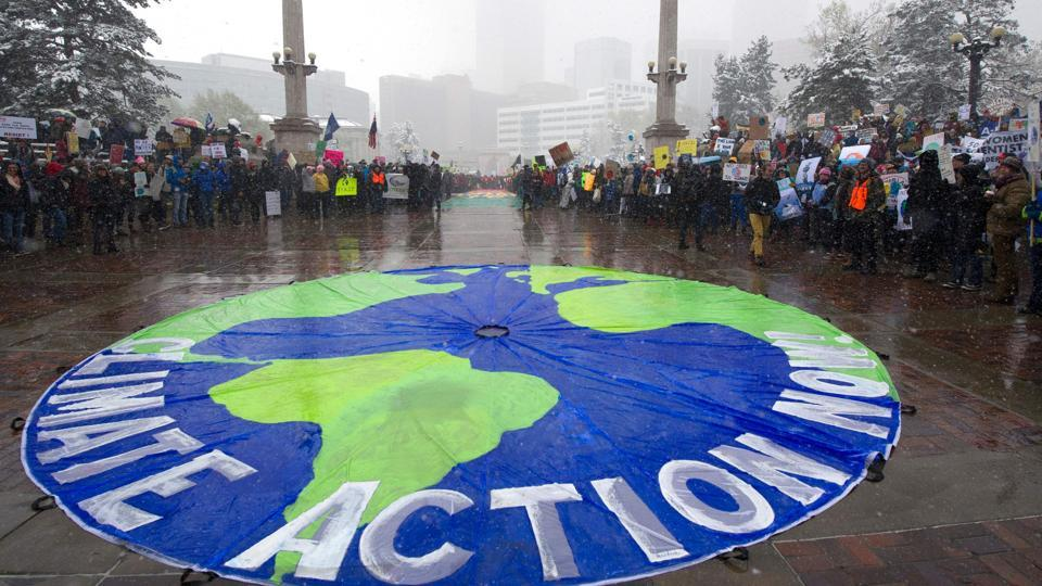 Thousands of demonstrators gather at Civic Center Park during the People's Climate March. Overseas, about three dozen events range from a protest in Vienna to a tree-planting event in Zambia. (Jason Connolly/AFP)