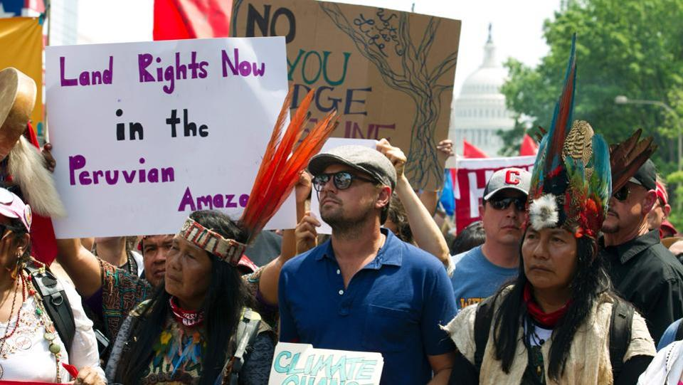 US actor Leonardo DiCaprio (2nd L) marches with a group of indigenous people from North and South America. Hollywood stars such as Leonardo DiCaprio, Jane Fonda and Kerry Washington among others came out to support the Climate March protest and urged masses to do their bit to save the environment. (Jose Luis Magana/AFP)