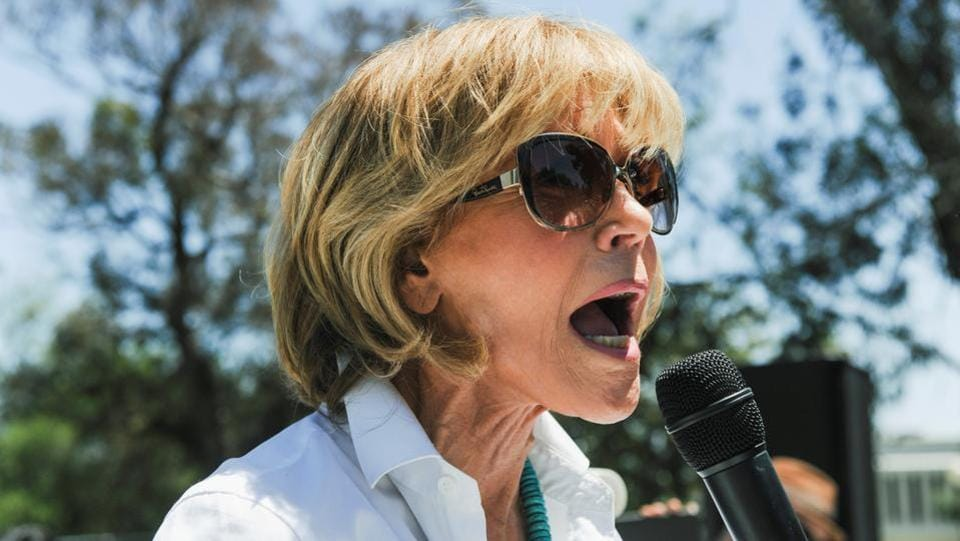 Actor and activist Jane Fonda speaks to the crowd. In his campaign, Trump called climate change a hoax. Last month he kept a promise to the coal industry by undoing climate-change rules put in place by Obama. (Andrew Cullen/REUTERS)