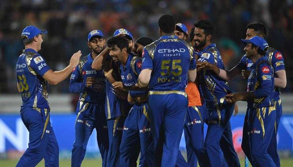 Mumbai Indians cricketers congratulate Jasprit Bumrah (centre) as they celebrate the Super Over victory against Gujarat Lions in their Indian Premier League match in Rajkot on Saturday.