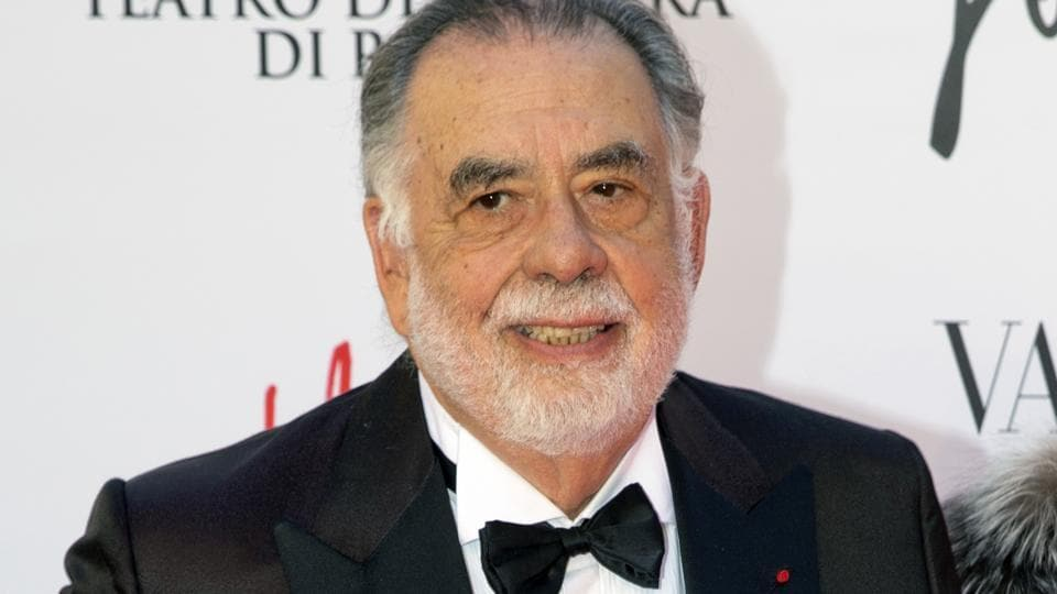 The Godfather director Francis Ford Coppola poses for photographers as he arrives for the premiere of Verdi's La Traviata at the Rome Opera House in April, 2017.