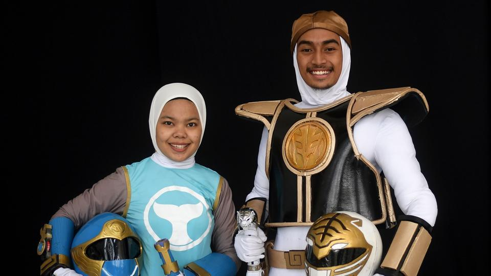 Muslim cosplay enthusiasts Azlyna Zaina (L) and Raja Mohd Rusydi, dressed as