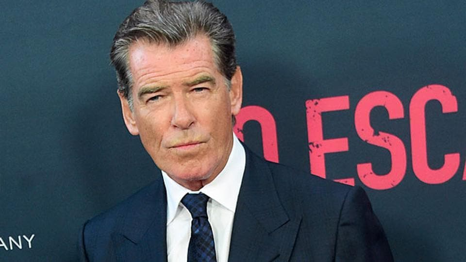 Pierce Brosnan poses on arrival for the Los Angeles premiere of the film No Escape. The film opens in theaters on August 26th. (AFP Photo)
