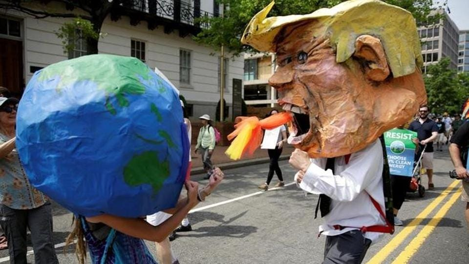 Protesters dressed as the earth and U.S. President Donald Trump pretend to fight during the People's Climate March near the White House in Washington, U.S. A sea of protesters swarmed in front of the White House to voice displeasure with President Donald Trump's stance on the environment and demand that he rethink plans to reverse the climate change policies backed by his predecessor. (Joshua Roberts/Reuters)