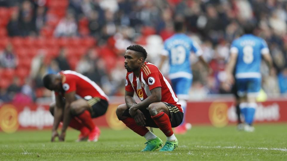 Sunderland's Jermain Defoe and Victor Anichebe look dejected after the 1-0 home defeat at the hands of Bournemouth, which confirmed their relegation to the second tier of English football.