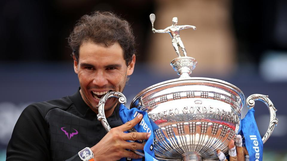 Rafael Nadal poses with the trophy after winning the Barcelona Open title.