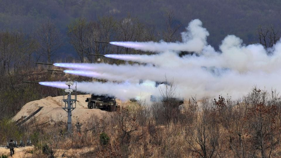 South Korean K-136 Kooryong 130mm 36-round multiple rocket launch system firing rockets during a media day presentation of a joint live firing drill between South Korea and the US at the Seungjin Fire Training Field in Pocheon, 65 kms northeast of Seoul. (JUNG Yeon-Je / AFP)