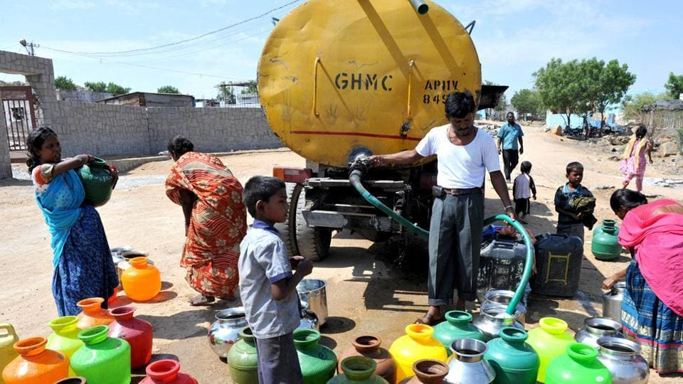 People fill plastic containers with water from a government tanker on the outskirts of Hyderabad.