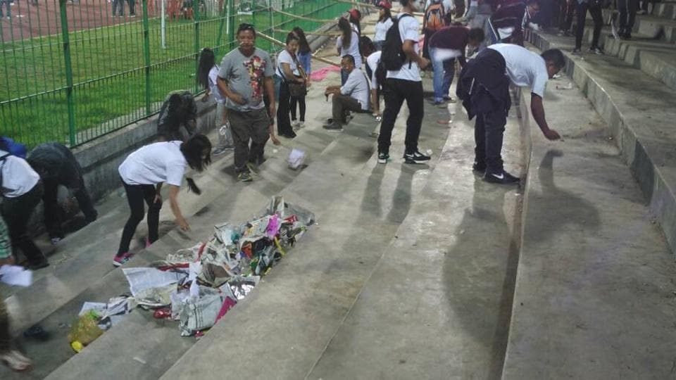 Aizawl FC fans clean up the Shillong Lajong stadium on Sunday after their team won the I-League football championship to become the first from North-East India to clinch the coveted national crown