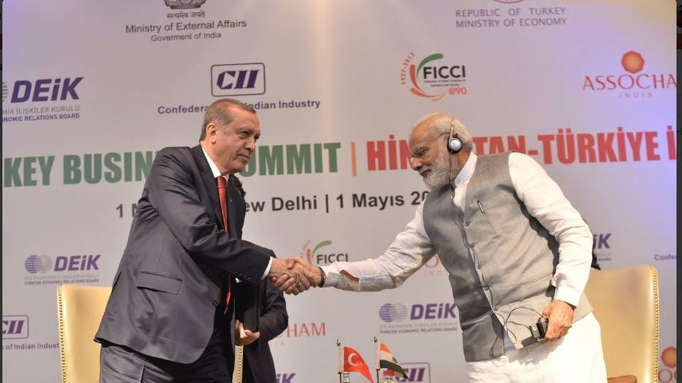 Prime Minister Narendra Modi and visiting Turkish President Recep Tayyip Erdogan at a business summit in New Delhi on Monday.