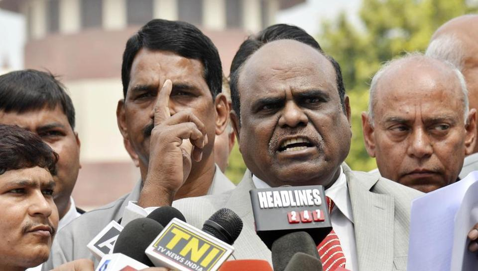 Calcutta high court judge CS Karnan addresses a press conference outside the Supreme Court in New Delhi on March 31.