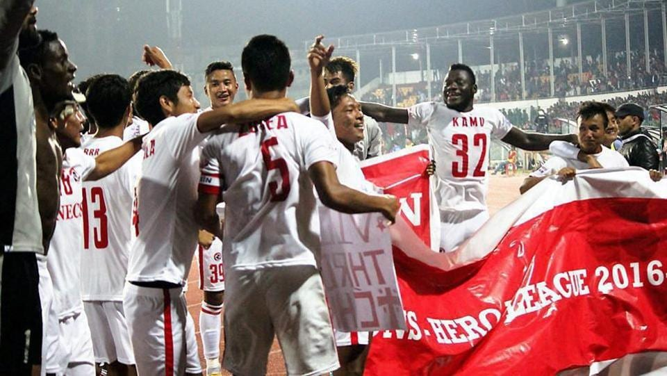 Aizawl FC players celebrate after they won the I-League title, following the 1-1 draw against Shillong Lajong FC in Shillong on Sunday.