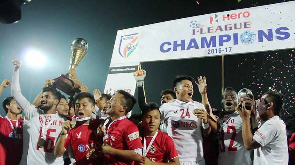 Aizawl FCplayers celebrate with the I-League trophy after they sealed the 2016-17 championship with a draw vs Shillong Lajong FC in Shillong on Sunday. (PTI)