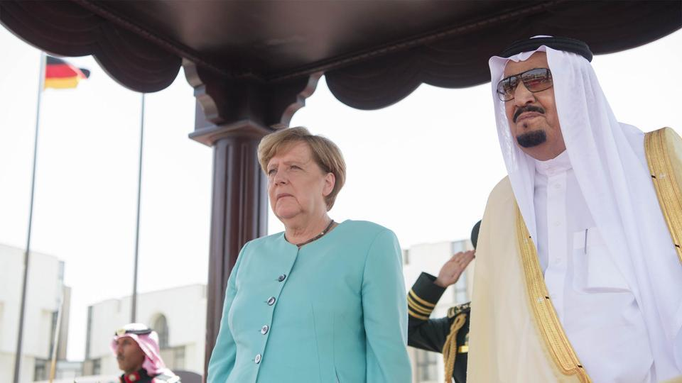 German Chancellor Angela Merkel  with Saudi Arabia's King Salman bin Abdulaziz al-Saud during a welcoming ceremony in Jeddah.