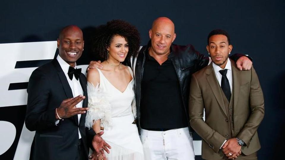 Actors Tyrese Gibson, Nathalie Emmanuell, Vin Diesel and Ludacris attend The Fate Of The Furious New York premiere at Radio City Music Hall in New York.