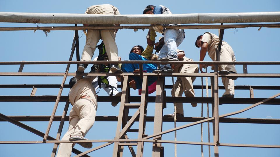 The woman was later taken to Link Road police station where the women constables tried to enquire why she had climbed the hoarding but the police could not understand her reply. They suspect that the woman could also be from Nepal.