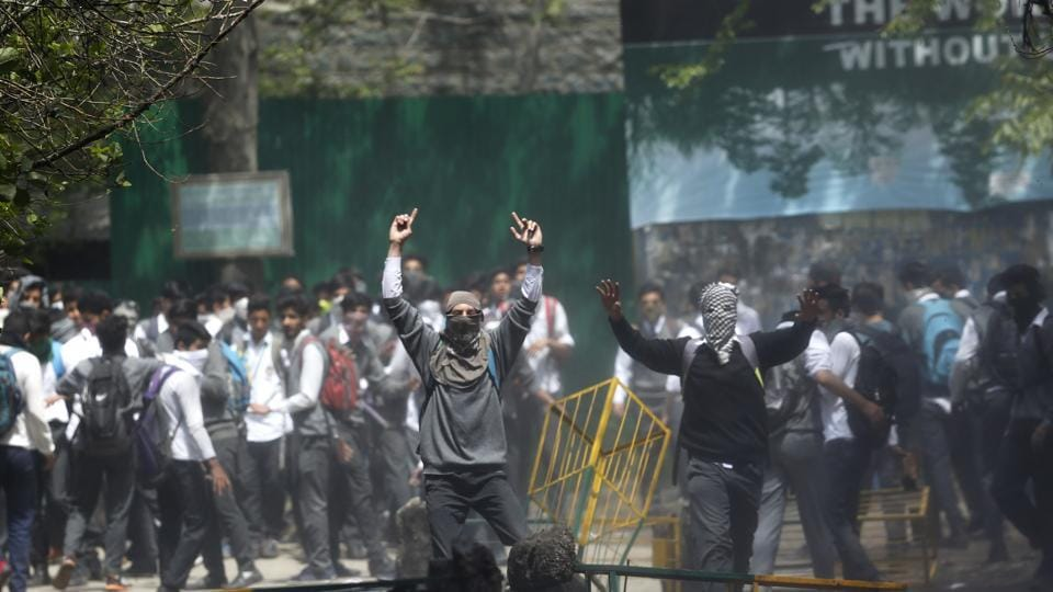 Kashmiri students shout slogans as they clash with police in Srinagar on April 24.