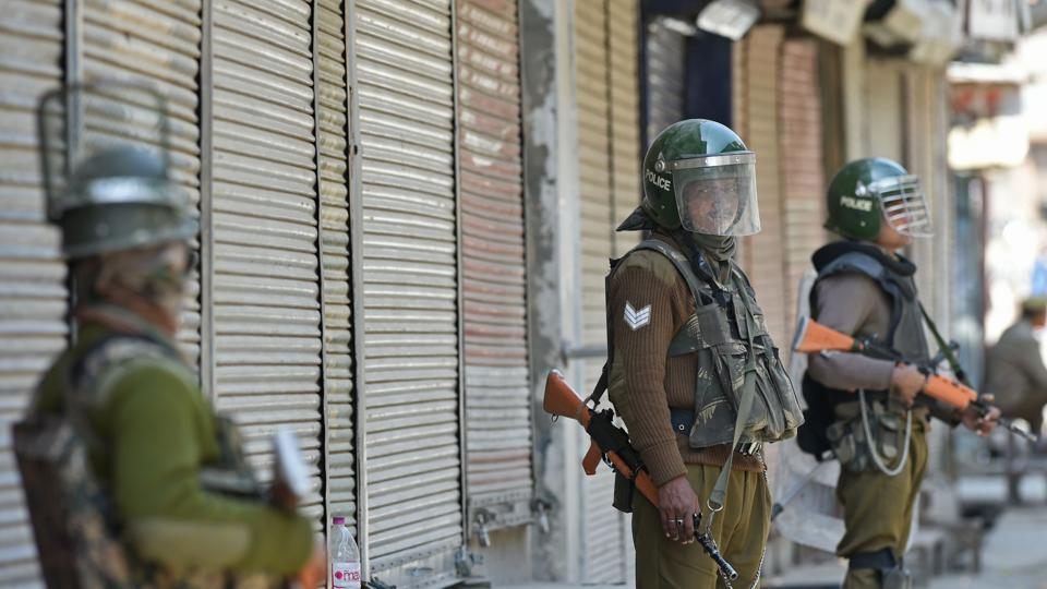 Paramilitary soldiers stand guard in Jammu and Kashmir.