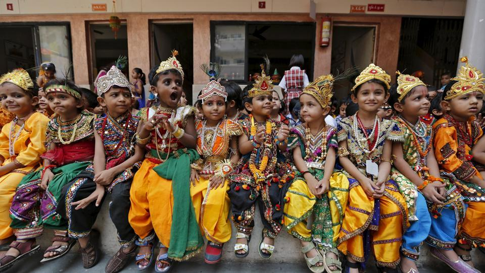 School children dressed as Hindu Lord Krishna, wait for their turn to perform during the celebrations on the eve of Janmashtami festival in Ahmedabad, India.
