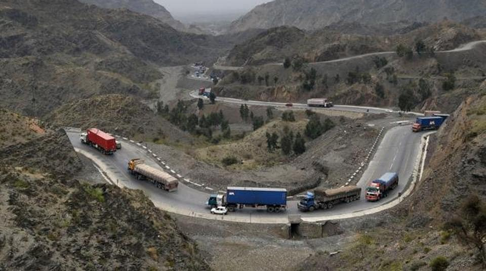 Trucks and other vehicles travel in the mountainous area near Torkham, close to the Pakistan-Afghanistan border, on March 21.