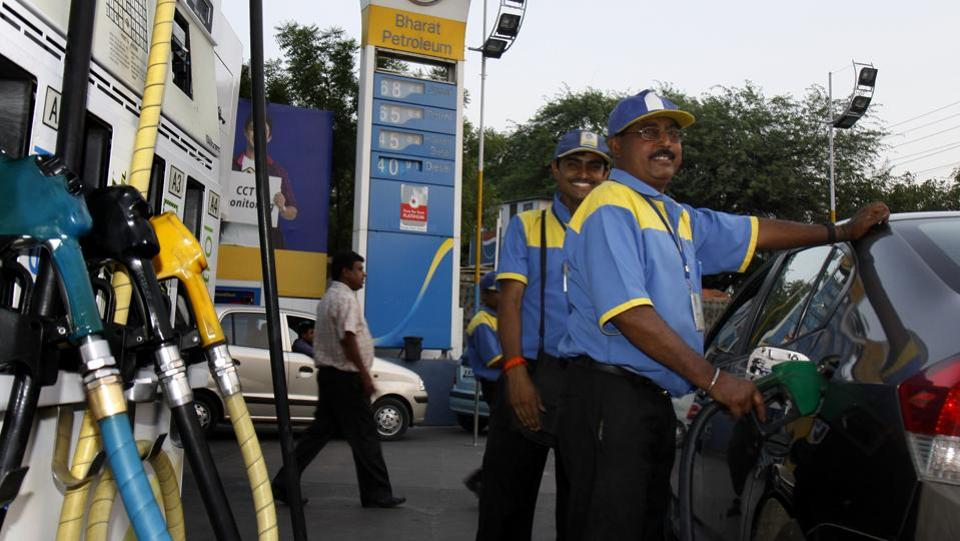 Vehicles queue up near a fuel station to fill their vehicles with petrol. The daily revision of petrol prices is being run as a pilot project in five cities before it is implemented nation wide.
