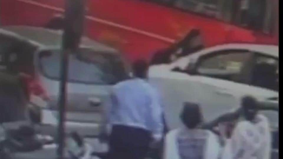 The video grab of the incident showing the man on the bonnet of the car.
