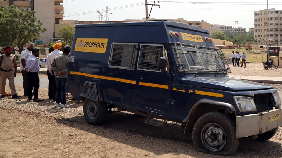 The Axis Bank cash van at the crime spot in Banur, 40 km from Patiala and 30 km fromChandigarh.