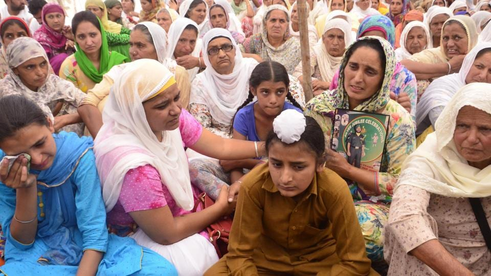 Family of naib subedar Paramjit Singh at his cremation in Vein Poin village in Tarn Taran district on Tuesday, May 2.