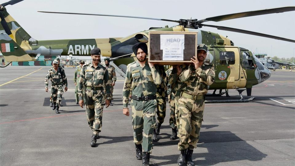 BSF jawans carry the coffin of head constable Prem Sagar in Jammu on Tuesday.
