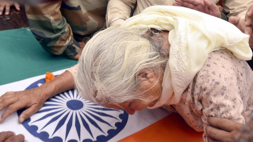 Joginder Kaur , mother of Indian army soldier Paramjit Singh, cries over the coffin of her son in Vein Poin village, 45 km from Amritsar, in Tarn Taran district on Tuesday, May 2.