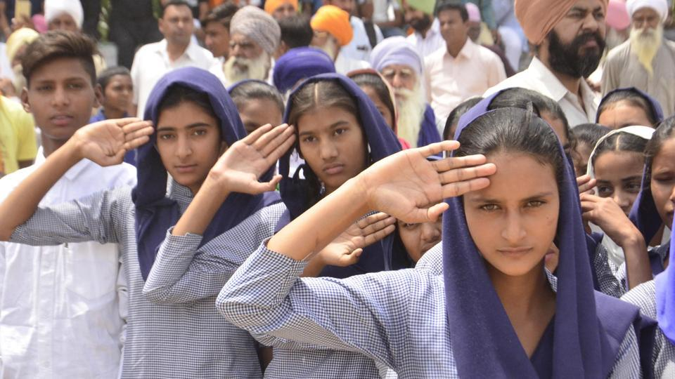 School students pay respects to naib subedar Paramjit Singh during his cremation at Vein Poin village in Tarn Taran district.