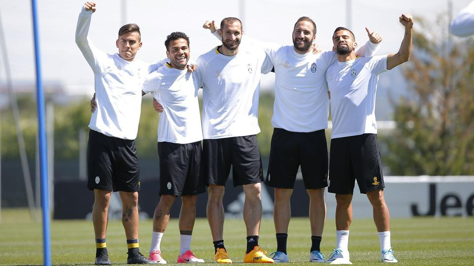 Juventus players pose for the camera during training, ahead of their UEFA Champions League semifinal first leg clash against Monaco on Tuesday.