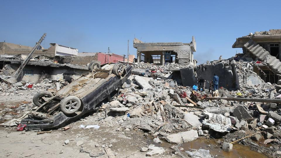 Rubble of destroyed houses in Mosul al-Jadida area, following air strikes targeting the Islamic State.