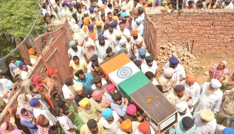 Relatives and residents carry the coffin of Indian Army soldier Paramjeet Singh ahead of his funeral at Vein Pein village, some 45kms from Amritsar on May 2, 2017. The Indian army accused Pakistan of killing two of its soldiers and mutilating their bodies in an 'unprovoked' rocket and mortar attack along the border.