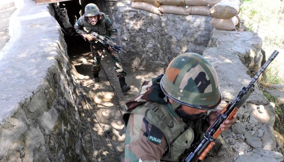 Indian Army soldiers take position near the Line of Control in Nowshera sector, about 145km from Jammu, on October 10.