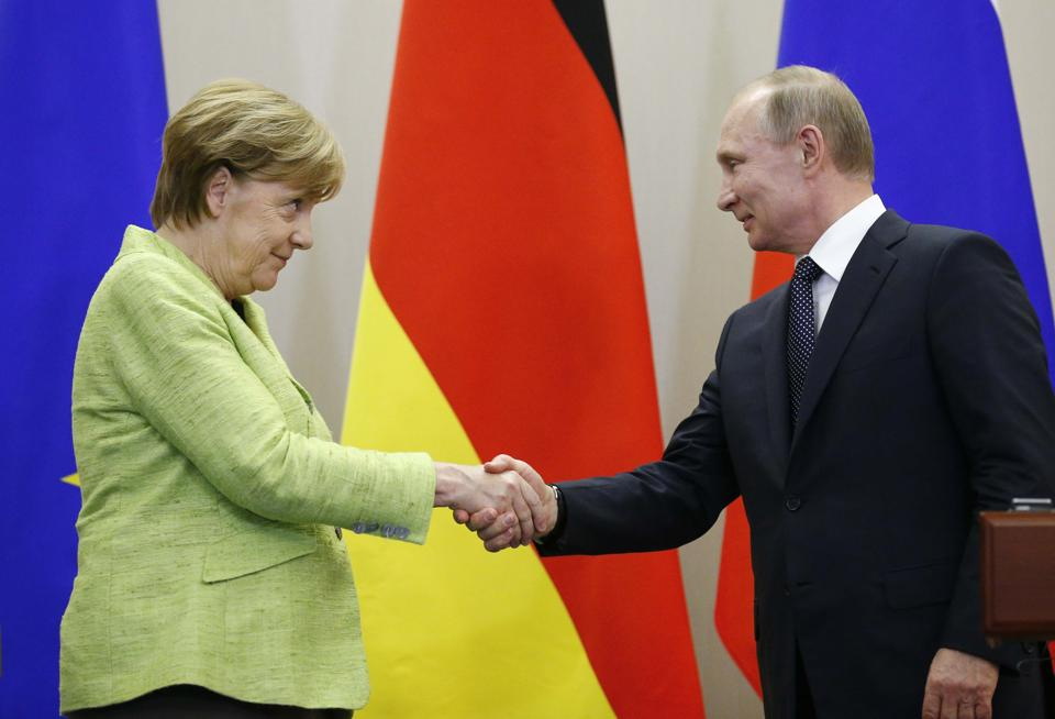 Russian President Vladimir Putin and German Chancellor Angela Merkel at a conference in Sochi on Tuesday.