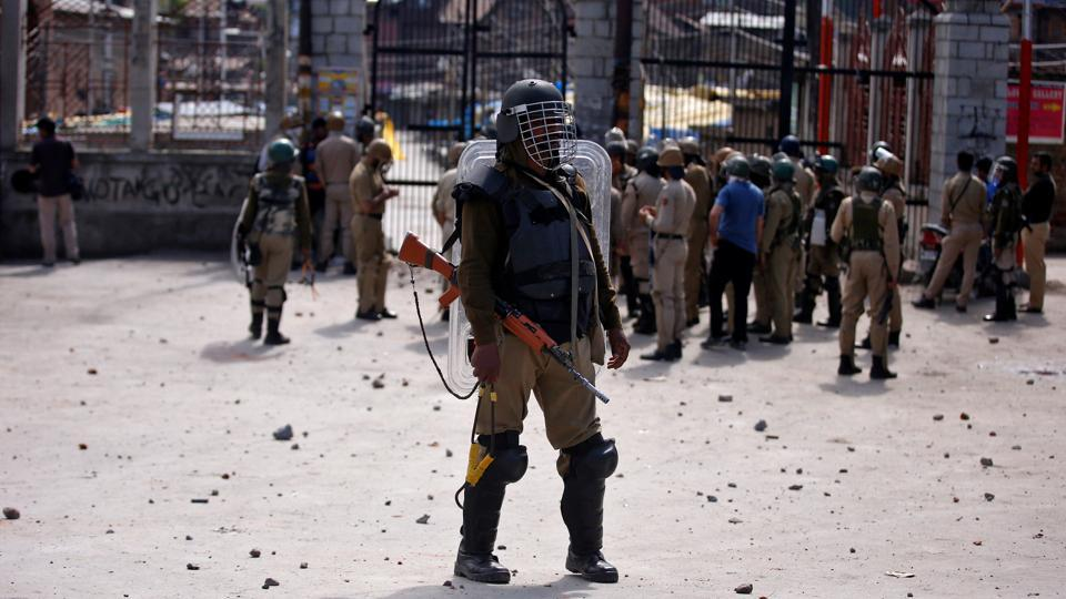 A policeman stands guard during a protest in Srinagar in Kashmir. The state has been reeling due to protests since a popular militant leader was gunned down by security forces last July.
