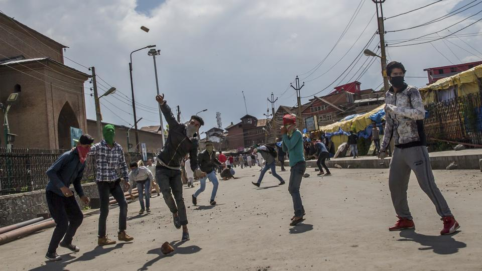 Kashmiri protesters throw rocks and bricks at government forces during a protest in Srinagar.
