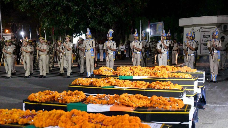 Soldiers giving gun salute to martyred CRPF personnel at Patna airport on Tuesday. 25 CRPF jawans were killed in a Maoist attack in Sukma on Monday.