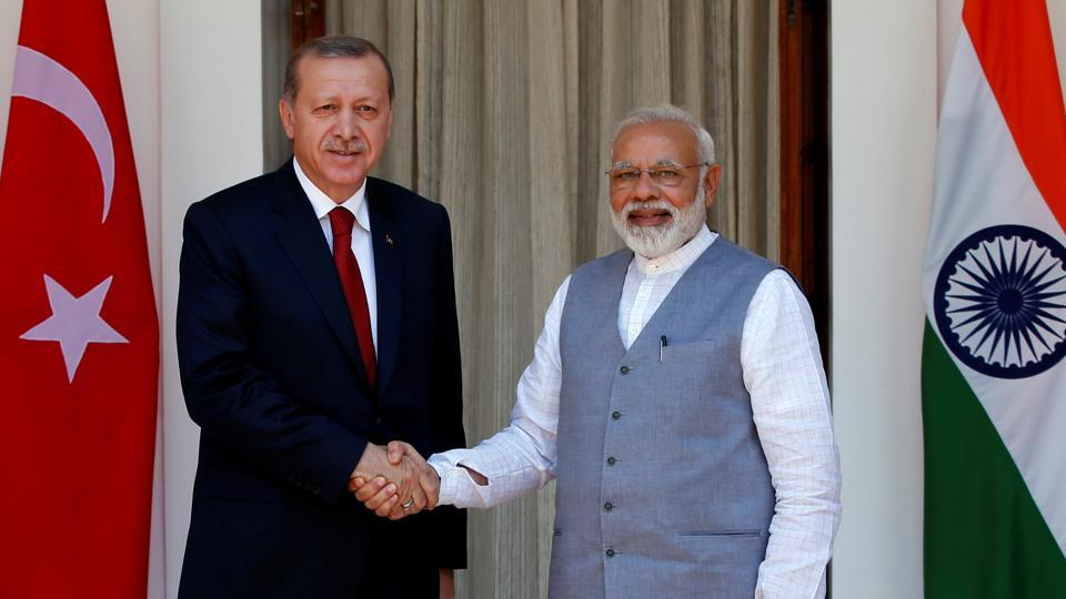 Turkish President Erdogan (L) shakes hands with Prime Minister Narendra Modi ahead of their meeting at Hyderabad House in New Delhi on Monday.