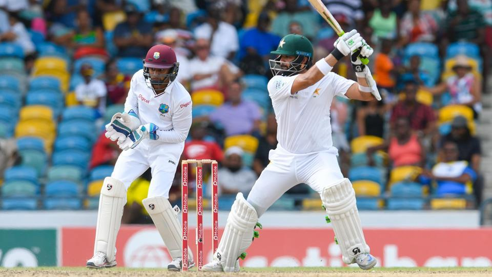 Azhar Ali (right) of Pakistan cricket hits a boundary during Day 2 of the 2nd Test match against West Indies cricket team at Kensington Oval, Bridgetown, Barbados on Monday.